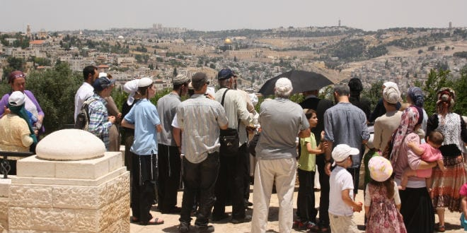Attendees of the re-enactment overlook the old city and the Temple Mount from the Arnona promenade in Jerusalem. (Photo: Adam Propp)