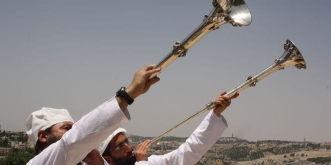 Kohanim (Jewish priests) blow the trumpet to celebrate the re-enactment of the Omer offering. (Photo: Adam Propp)