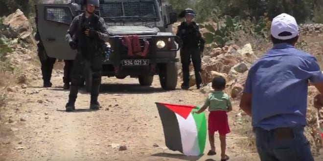 Arab boy approaches IDF jeep in Ni'lin (YouTube video capture)