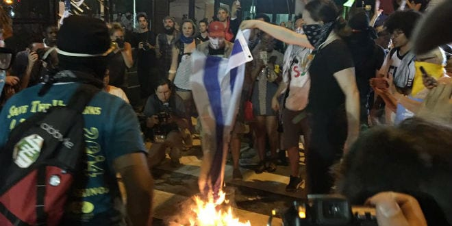 Protesters burn the Israeli flag outside of the Wells Fargo Center where the Democratic National Convention is being held this week. (Photo: Twitter)