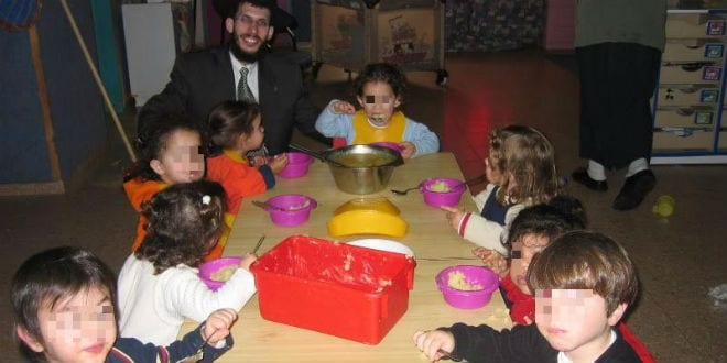 Children enjoy a nutritious meal provided by the Colel Chabad daycare center. (Photo: Colel Chabad)