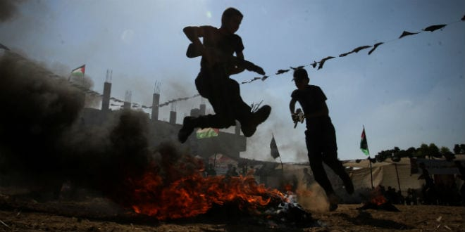 Young Palestinians take part in a military-style exercise at a summer camp organised by the Islamic Jihad movement in Khan Yunis in the southern Gaza Strip, during the youngsters' summer school vacation, on July 14, 2016. Hundreds of youngsters between the age of six and 16 can participate in the summer camp where they receive military as well as religious training. (Photo: Abed Rahim Khatib/ Flash90)