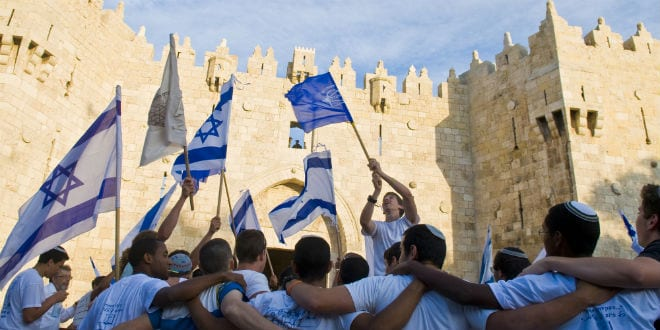 Israeli men celebrate on Jerusalem day in front of Damascus gate in east Jerusalem on May 20 2012 , Jerusalem day marks the anniversary of the city's reunification in 1967. (Photo: Kobby Dagan / Shutterstock.com)