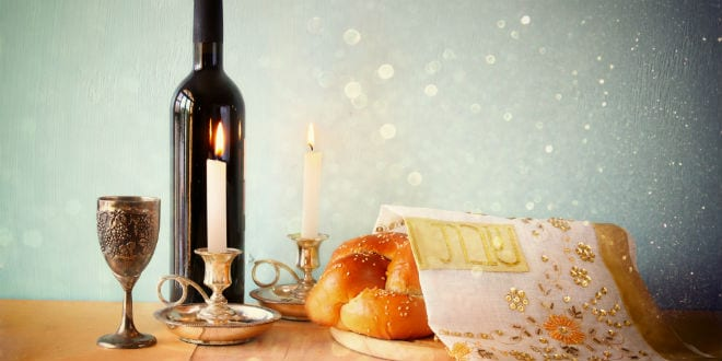 Illustrative: a cup of wine, candles and challah that typically adorn the Sabbath table. (Photo: Shutterstock.com)