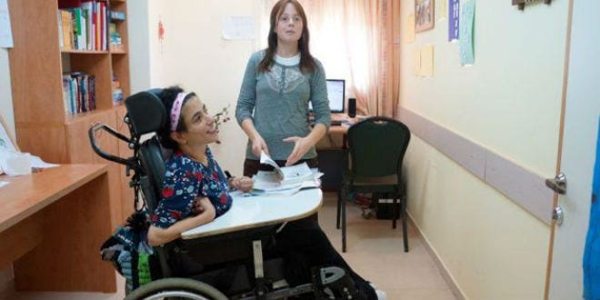 A patient and her caretaker at the Colel Chabad Grabski Center in Migdal HaEmek. (Photo: Colel Chabad)