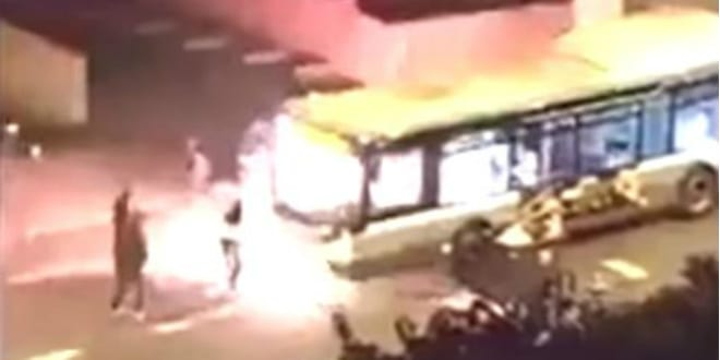 Firebomb attack on bus (YouTube video capture)