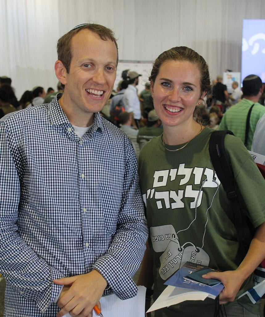 Rabbi Tuly Weisz of Israel365 presenting a gift bag to the 50,000 immigrant to Israel Rebecca Glanzer. (Courtesy)