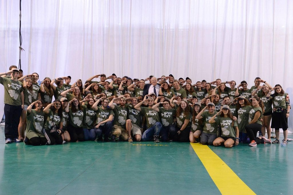 75 new arrivals to Israel who will soon be joining the Israeli army salute President of Israel Reuven Rivlin. (Courtesy of Nefesh B'Nefesh)