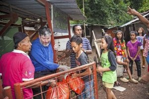 Rabbi Tovia Singer distributing food with a Muslim organization in Indonesia. (Courtesy)