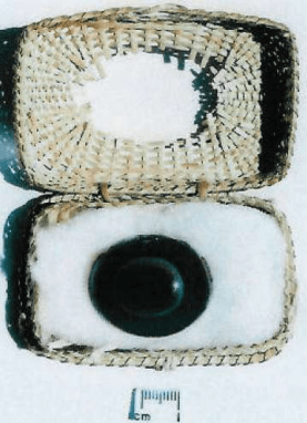 The sardonyx stone. in the papyrus casket in which it was carried (Courtesy of owner)