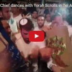 Israeli Police Chief Dances With Torah Scrolls in Tel Aviv
