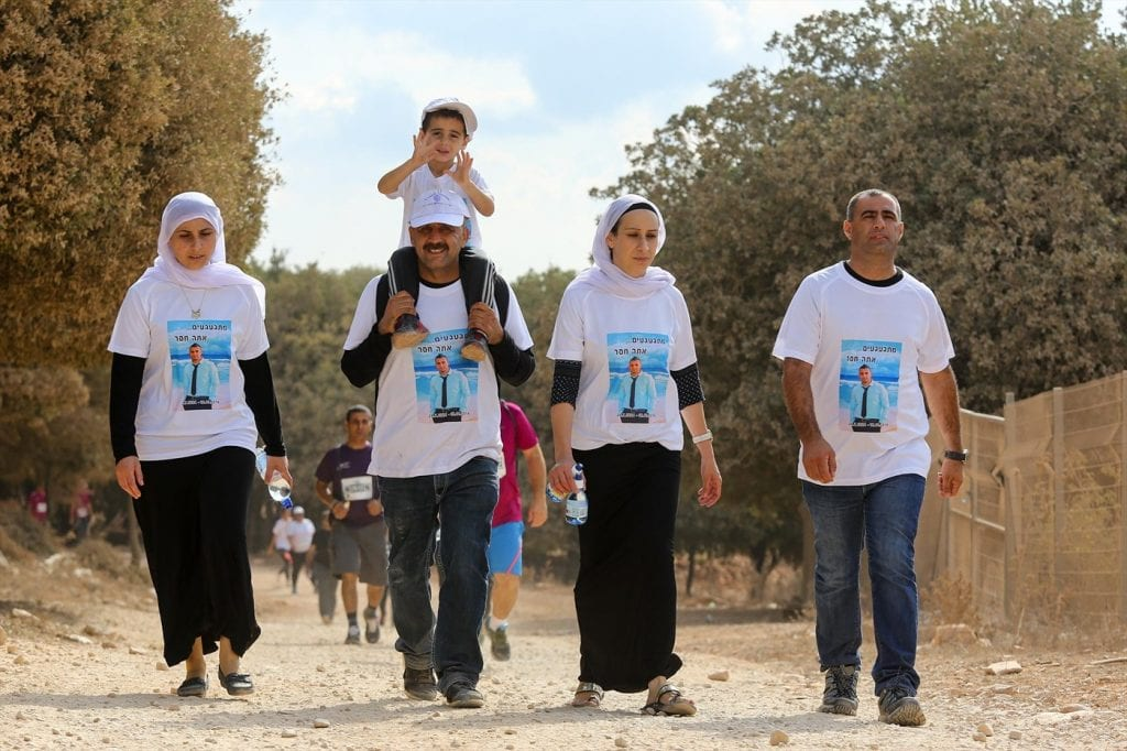 A Druze family honors its fallen IDF soldier at the memorial run. (Courtesy LIBI)
