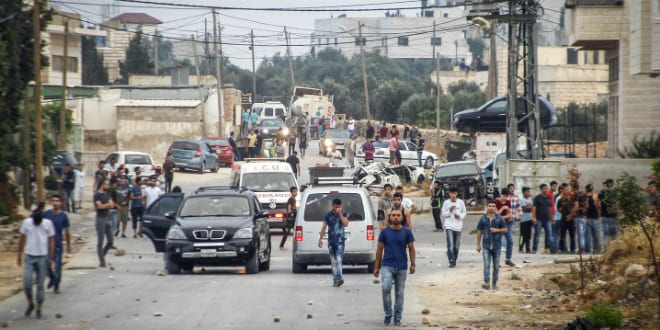 Clashes between IDF troops and rioting Arab mobs in Dura (Photo by Flash 90)