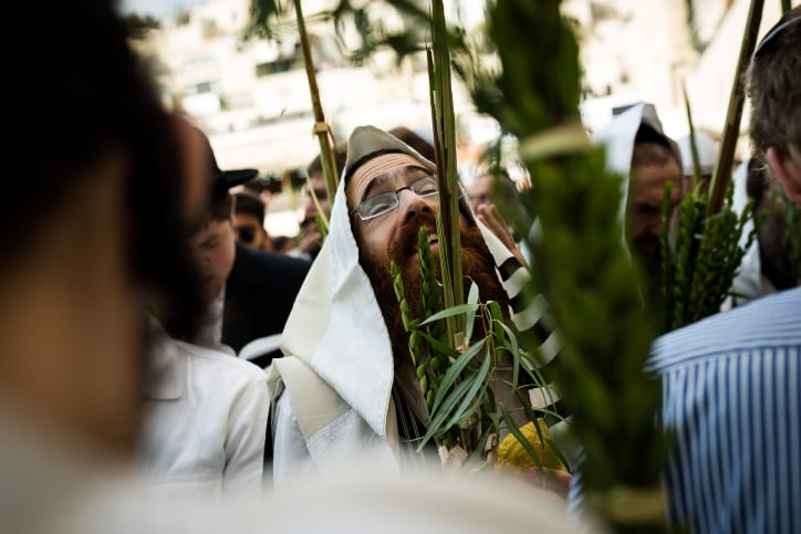 Jewish worshippers cover themselves with prayer shawls as they pray in front of the Western Wall, Judaism's holiest prayer site, in Jerusalem's Old City, during the Cohen Benediction priestly blessing at the Jewish holiday of Sukkot, October 19, 2016. (Photo by Sebi Berens/Flash90)