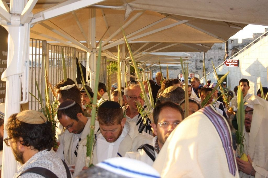 "Religious Jewish men holding the ""Four Species"" of Sukkot wait to enter the Temple Mount compound. (Facebook Page: Students for the Temple Mount)"