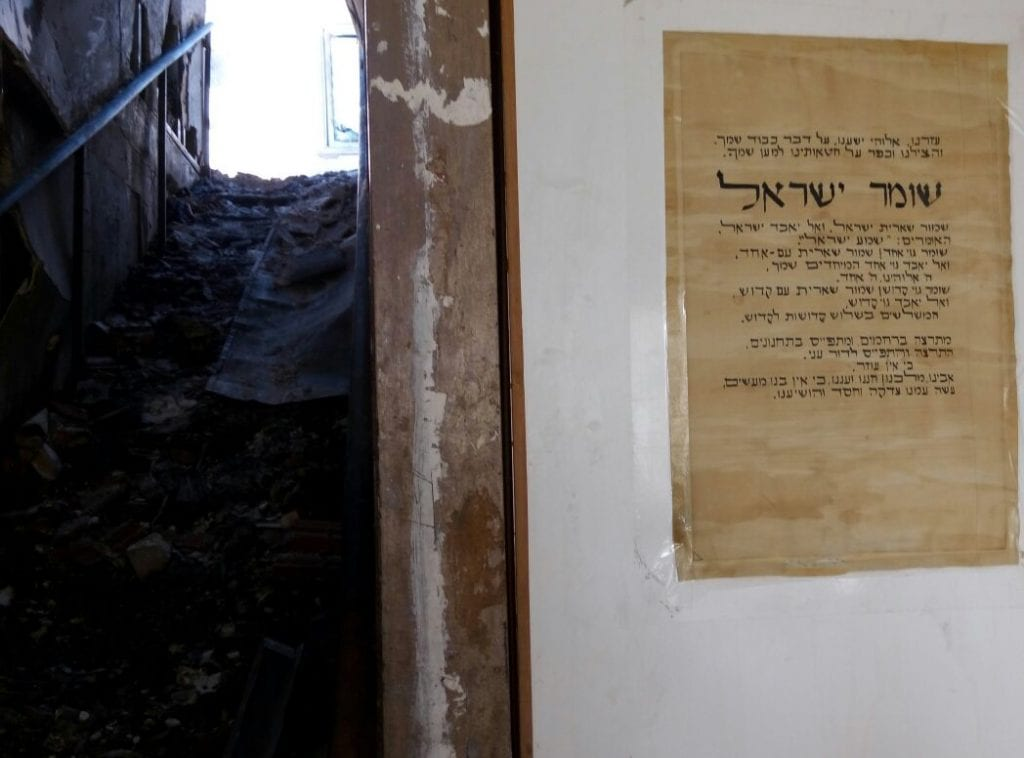 The burned stairwell and intact prayer at the Halperin house in Beit Meir. (Israel365)