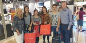 From left, Donna Jollay, the three Halperin siblings, and Rabbi Tuly Weisz at the Beit Shemesh shopping mall (Israel365)